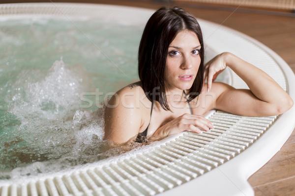 Young woman in the hot tub Stock photo © boggy