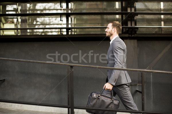Businessman in suit with leather handbag goes to work Stock photo © boggy