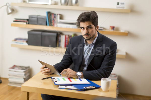 Businessman analyzing investment charts on digital tablet at off Stock photo © boggy