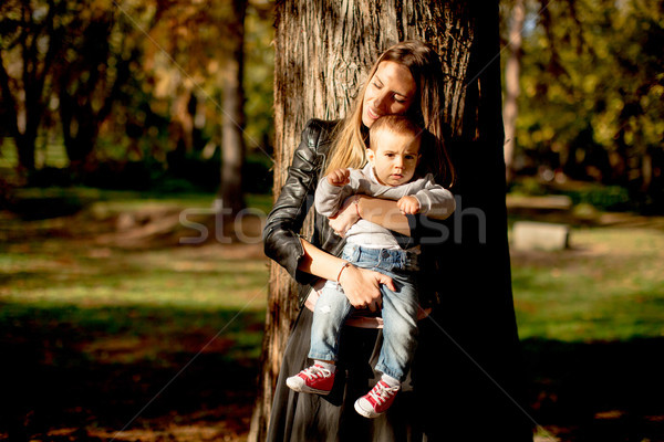 Young mother and baby boy in autumn park Stock photo © boggy