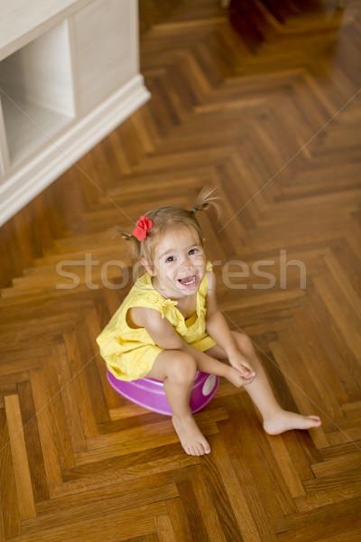 Little girl on potty Stock photo © boggy