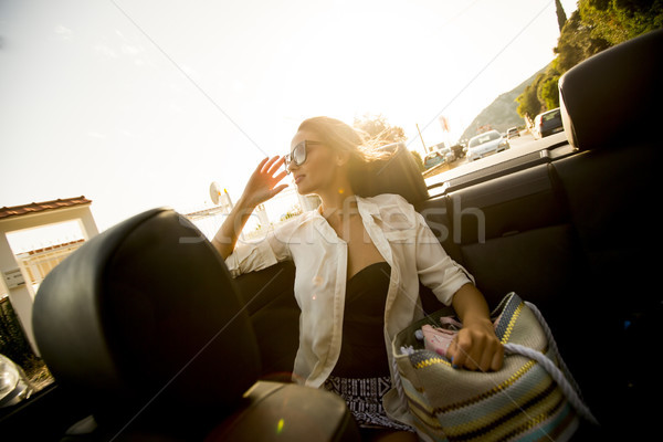 Pretty young woman driving in the cabriolet car Stock photo © boggy