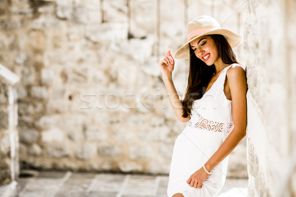 Stock photo: Young woman with a hat at summer outdoors