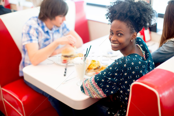 Young multiracial friends enjoying in the diner Stock photo © boggy