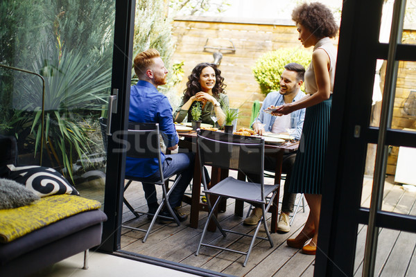 Stock photo: Young people have lunch in the backyard