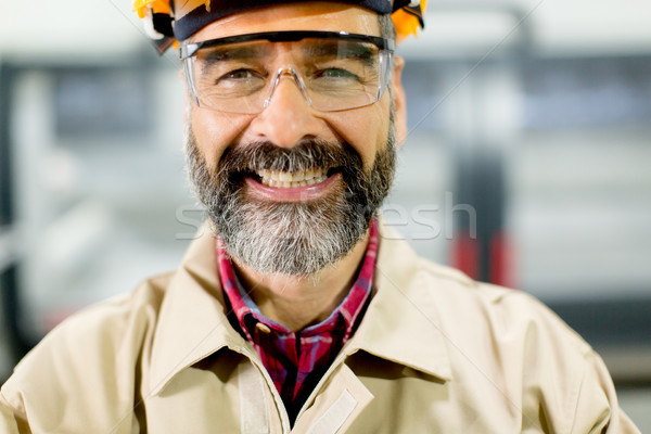 Portrait of middle-aged engineer in factory Stock photo © boggy