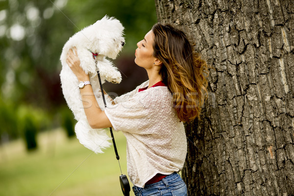 Young woman with a maltese dog Stock photo © boggy