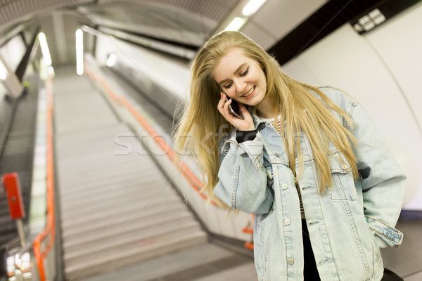 Young woman standing on a subway station Stock photo © boggy