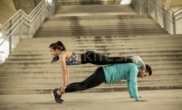 Athletic young couple doing stretching  exercises together Stock photo © boggy