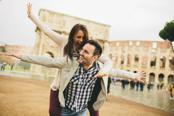 Loving couple in front of Colosseum in Rome Stock photo © boggy