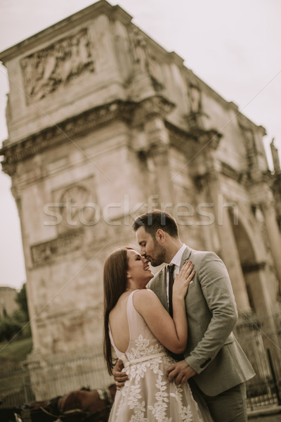 Young wedding couple by Arch of Constantine in Rome Stock photo © boggy