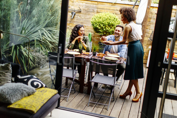 Cheerful young people have lunch in the courtyard and have a fun Stock photo © boggy