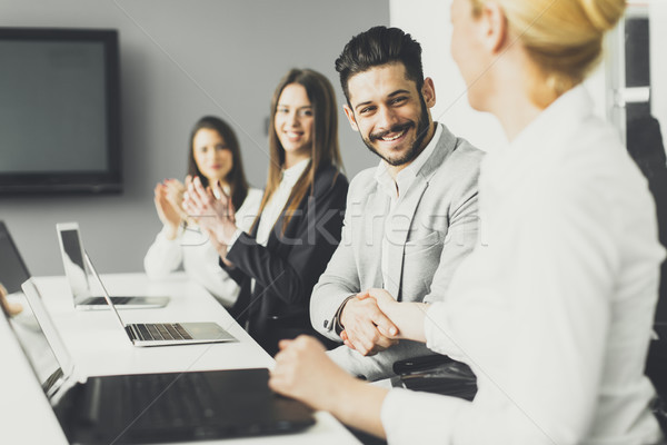Stock photo: Business people applauding at conference