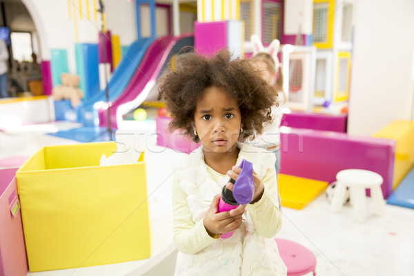 Cute african american little girl in playroom Stock photo © boggy