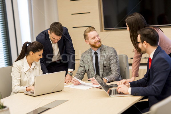 Group of happy young business people in a meeting at office Stock photo © boggy