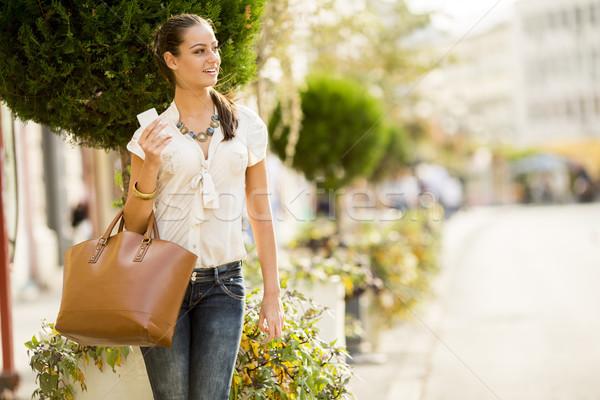 ファッショナブル ブルネット 女性 ハンドバッグ 徒歩 通り ストックフォト © boggy