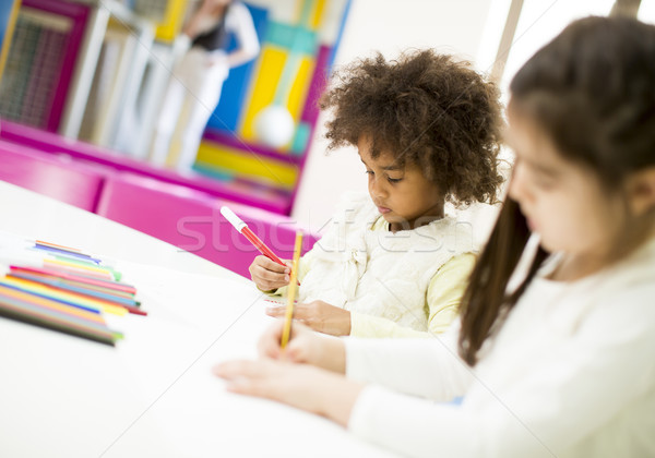 Multiracial children drawing in the playroom Stock photo © boggy
