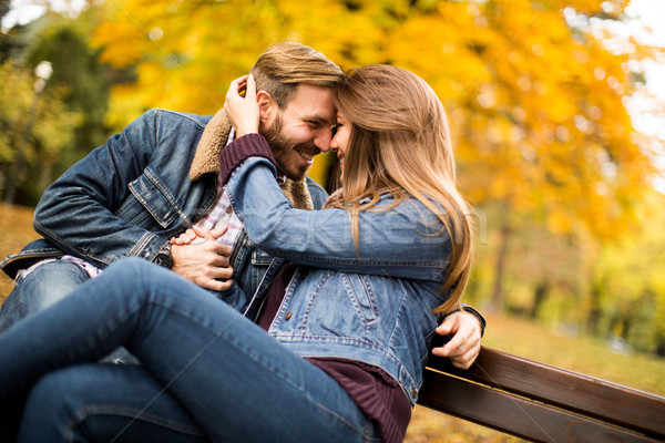 Young couple in the autumn park Stock photo © boggy