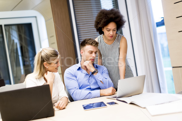 Young multiracial people working in the office Stock photo © boggy