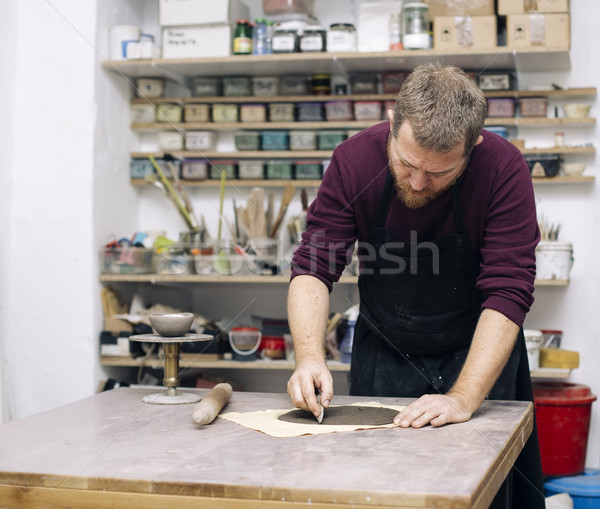 Skilled master preparing clay workpieces for new his creations Stock photo © boggy