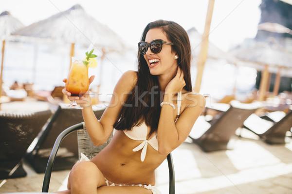 Stock fotó: Fiatal · nő · tengerpart · nyár · tenger · pihen · dzsúz
