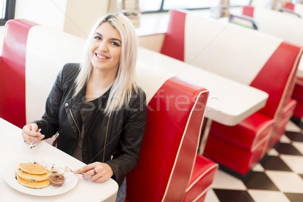Young woman having lunch in a diner Stock photo © boggy