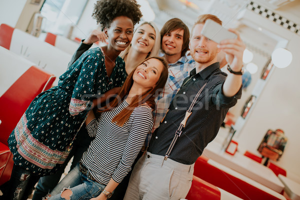 グループ 若者 携帯電話 幸せ ダイナー ストックフォト © boggy