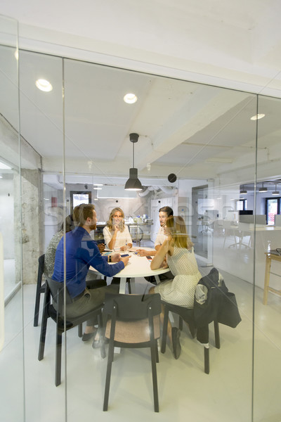 Modern business team developing the company's strategy at the of Stock photo © boggy