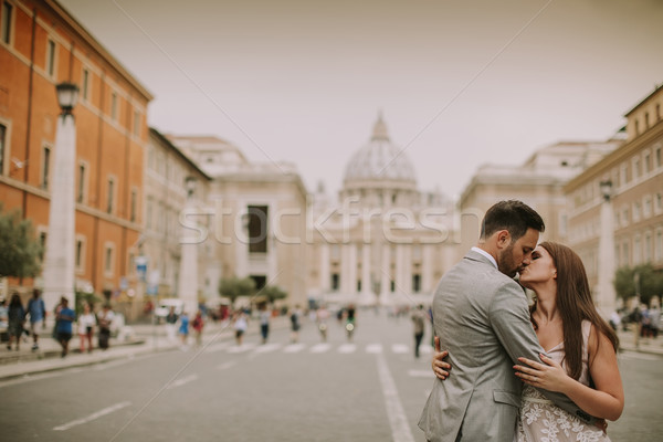 Young wedding couple by Saint Peter cathedral in Vatican Stock photo © boggy