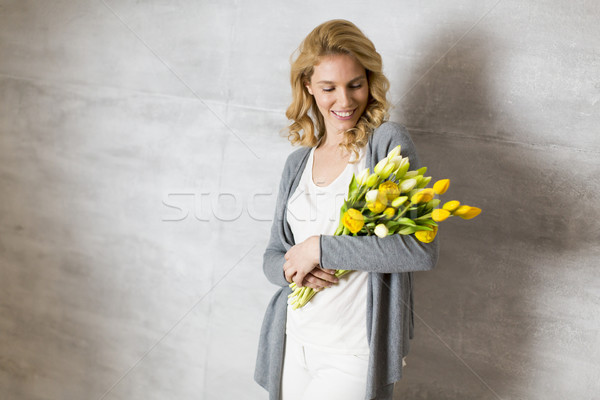 Young woman with bouqet of yellow tulip Stock photo © boggy