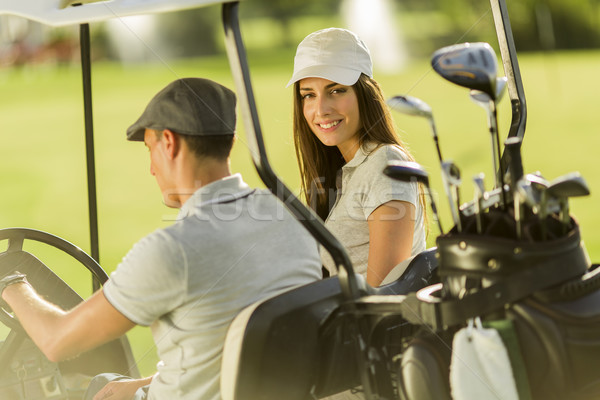 Stock photo: Young couple at golf cart