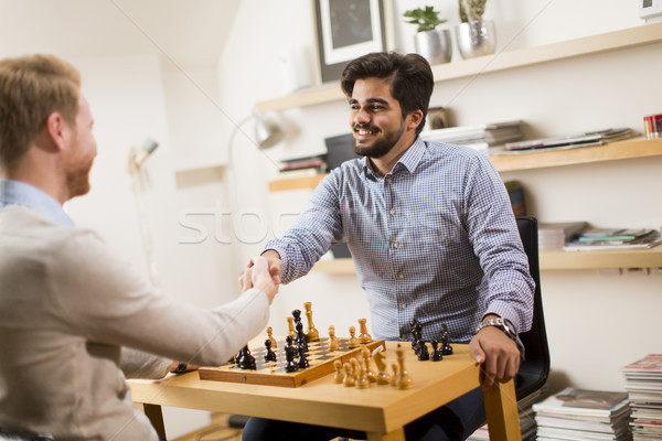 Friends playing chess Stock photo © boggy