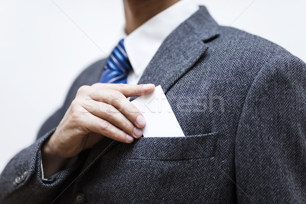 Businessman taking a blank business card out of his pocket Stock photo © boggy