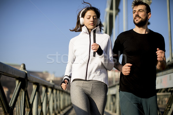 Stock photo: Young couple running in the morning