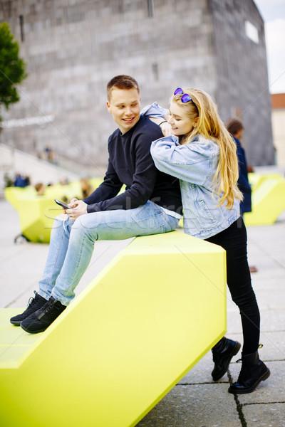 молодые люди сидят скамейке Вена Австрия современных Сток-фото © boggy