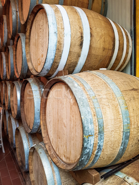 Wine barrels stacked  in the old cellar Stock photo © boggy
