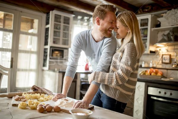 Szerető pár tészta konyha otthon nő Stock fotó © boggy
