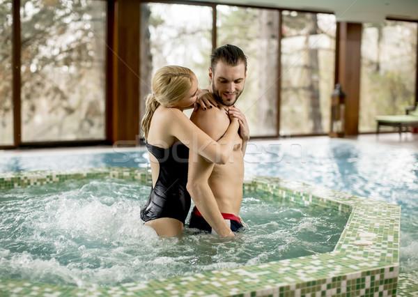 Amoroso casal relaxante banheira de hidromassagem estância termal água Foto stock © boggy
