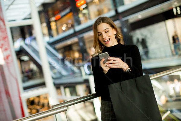 Modern woman in shopping mall Stock photo © boggy