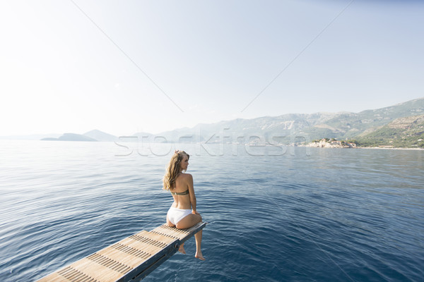 Young attractive woman sitting on  luxury yacht floating at sea Stock photo © boggy