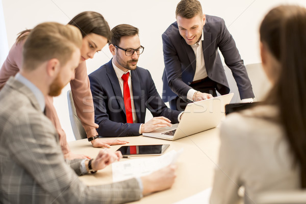 Young business people work in a team in a modern office Stock photo © boggy