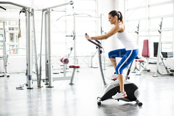 Aerobics spinning woman exercise workout at bikes gym Stock photo © boggy