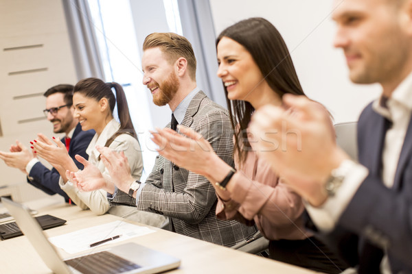 Group of business people clapping their hands at the meeting Stock photo © boggy