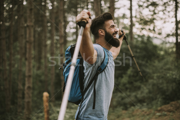 Young bearded hiker in mountain Stock photo © boggy