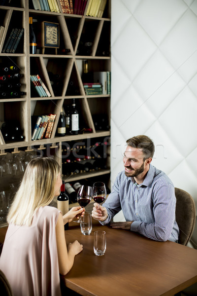 Lovely young couple in the wine bar Stock photo © boggy