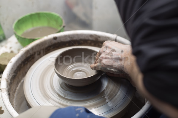 Artista argila cerâmica girar roda Foto stock © boggy