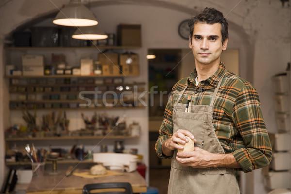 Yakışıklı genç çanak çömlek atölye kil Stok fotoğraf © boggy