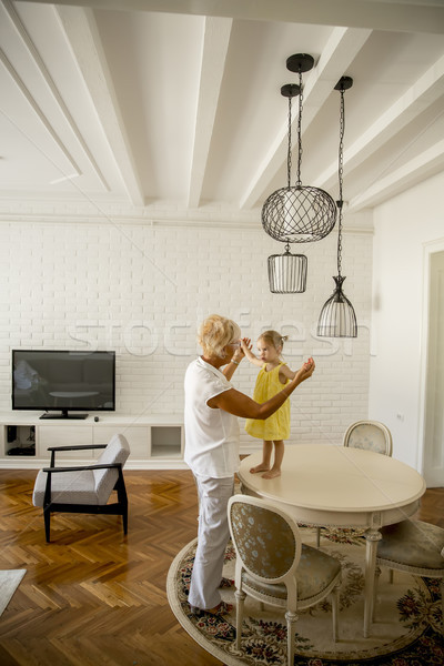 Grandmother and granddaughter having fun in the room Stock photo © boggy
