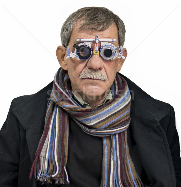 Man at ophthalmologist Stock photo © boggy