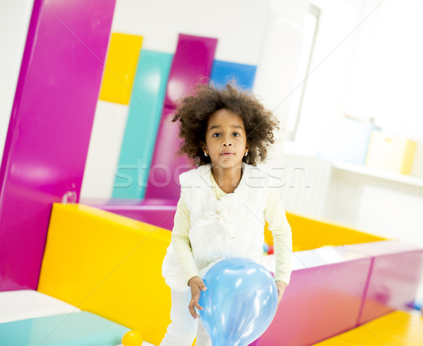 African american little girl with a balloon Stock photo © boggy